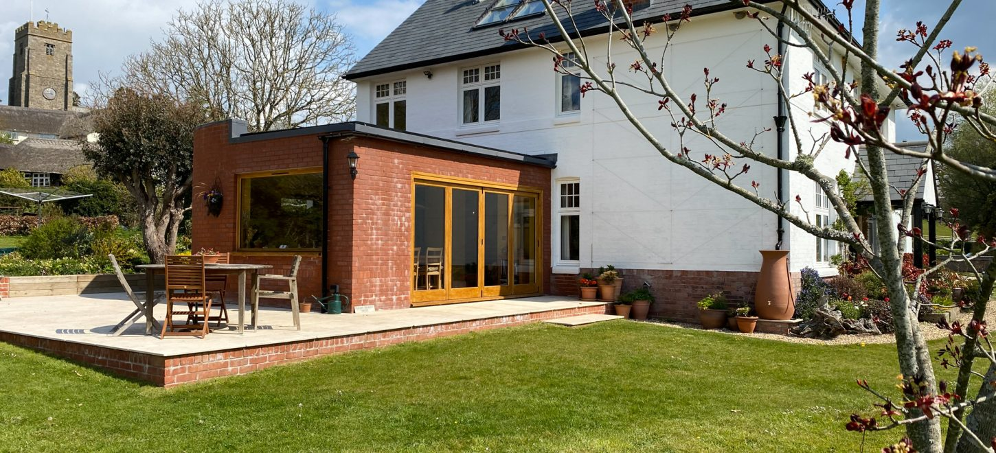 flat roof extension with curved wall
